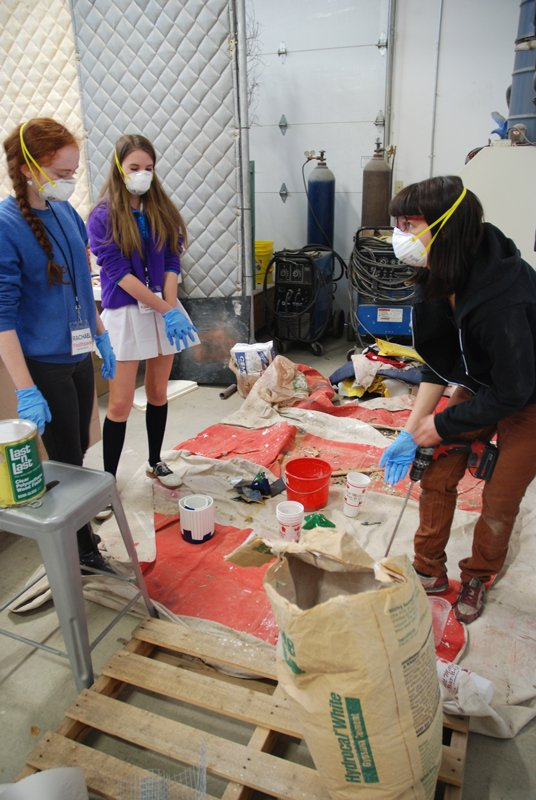 You[th]Pace Teen Art Council members work with Spring 2014 International Artist-in-Residence Liz Glynn in the Artpace studio to mix concrete.