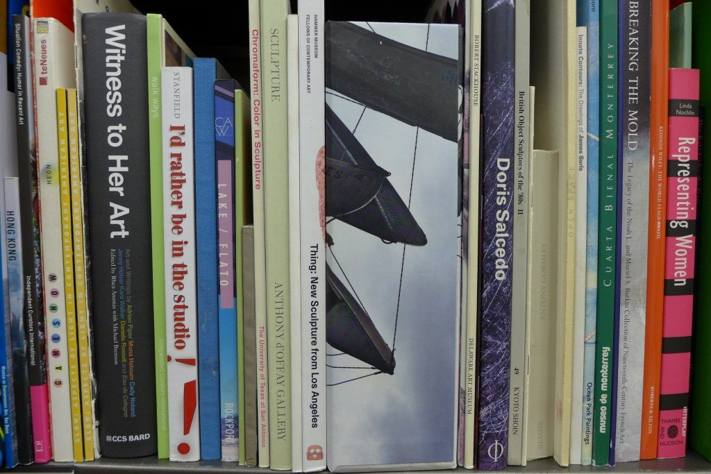 A shelf in the Artpace Archive and Resource Library